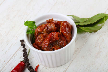 Dry tomato in olive oil with pepper