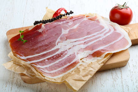 serrano: Jamon serrano with pepper and thyme leaves Stock Photo
