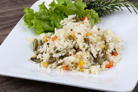 Rice with vegetables - peas, beans and pepper Stock Photo