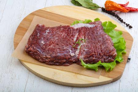 machete: Raw beef steak machete with thyme leaves Stock Photo