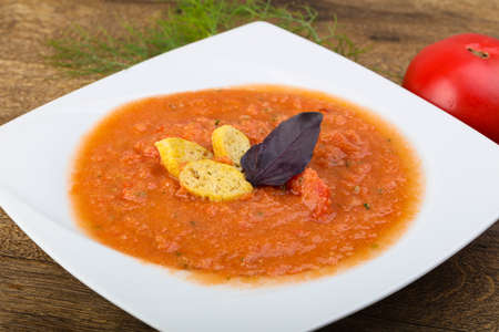cold soup: Famous Spanish Gazpacho tomato cold soup on the wood background