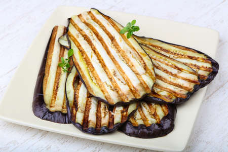 Grilled eggplant with thyme on the plate Stock Photo