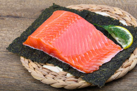 nori: Salmon fillet on nori background with dill and lemon