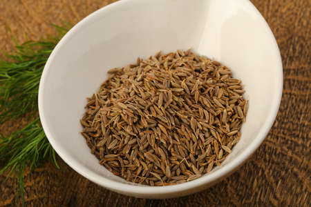 Cumin seeds heap on the wood background Stock Photo