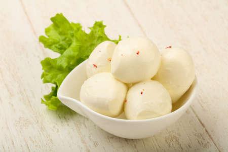 midi: Midi Mozzarella balls in the bowl over wood background