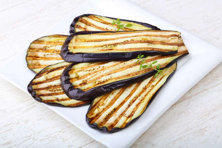 Grilled eggplant with thyme on the plate