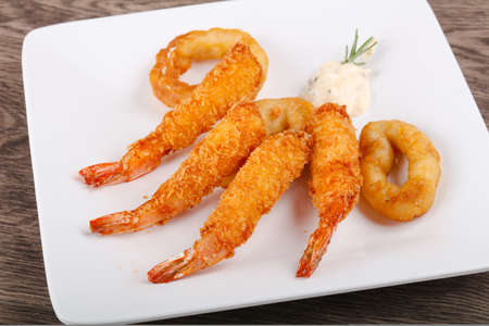 Squid and Shrimp Tempura with garlic sauce Stock Photo