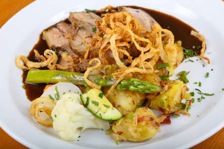 Czech cuisine - roasted pork with asparagus and vegetables