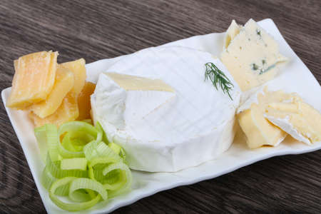 Cheese platter with brie, blue and parmesan Stock Photo