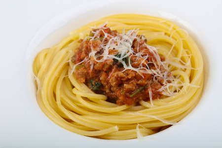 Spaghetti bolognese with parmesan and basil leaves Stock Photo