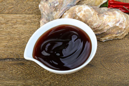 Oyster sauce in the bowl with shell