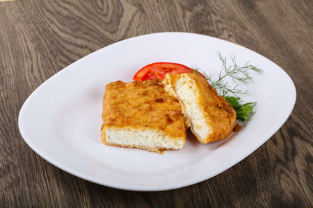 Baked cheese with dill leaves and tomato Stock Photo