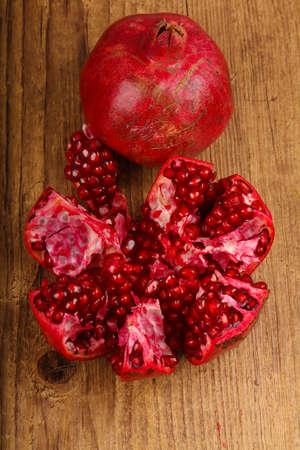 Fresh sweet ripe Pomegranate fruit on the wood background