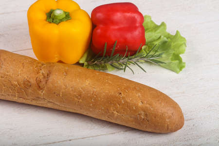crust: Crust baguette with vegetables over wooden backgroind Stock Photo