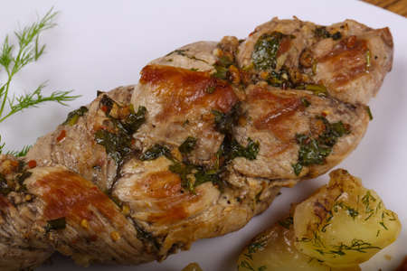 Baked pork with potato served sauce and dill