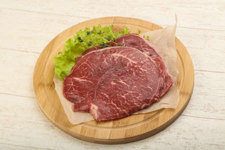 Raw beef schnitzel with spices ready for griil Stock Photo