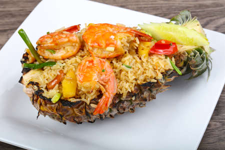 Rice with prawn and spices baked in pineapple