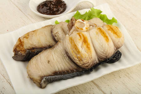 catfish: Grilled shark steak with pepper sauce and salad leaves