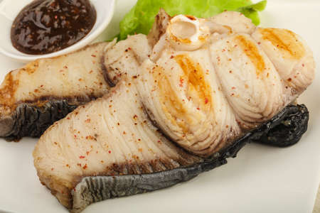 shark catfish: Grilled shark steak with pepper sauce and salad leaves