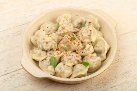 Boiled dumplings with herbs, oil and spices