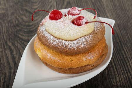 Pancake with cherry and shugar powder