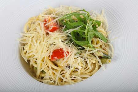 Pasta with mushroom served rucola Stock Photo