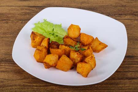 Baked potato with herbs Stock Photo