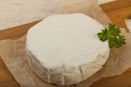 white wine: Camembert cheese with parsley over the wooden background Stock Photo