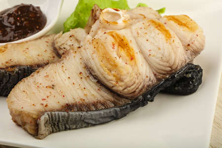 bagre: Grilled shark steak with pepper sauce and salad leaves