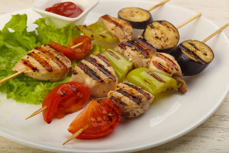 Chicken and vegetables skewer with tomato, pepper and eggplant