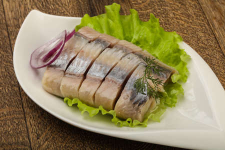 Sliced Herring fillet with dill and onion Reklamní fotografie