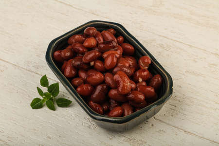 Kidney beans in the bowl over wooden background