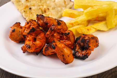 Indian traditional cuisine - Tandoori chicken with naan Stock Photo