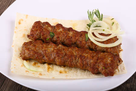 Hot Juicy Grilled Kebab with onion and parsley