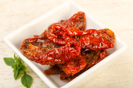 spice: Dried tomato in olive oil with basil leaves