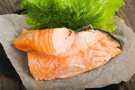 Steamed salmon with dill and salad leaves