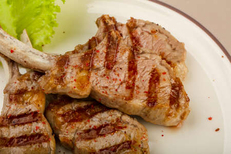 Grilled lamb with tomato sauce served salad leaves