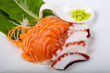 Fresh cold Salmon and Octopus sashimi with wasabi