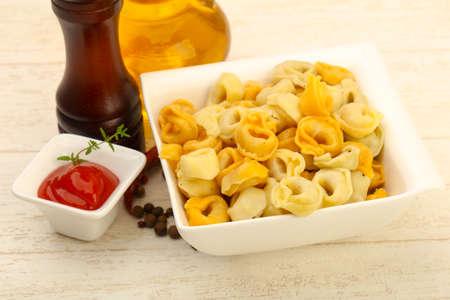 tortellini: Ravioli pasta served olive oil and pepper