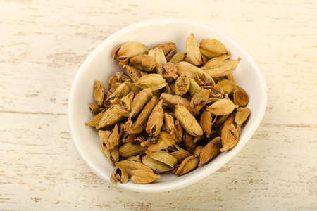 Dry cardamom seeds heap in the bowl