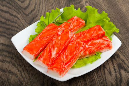 Crab sticks over the wooden background