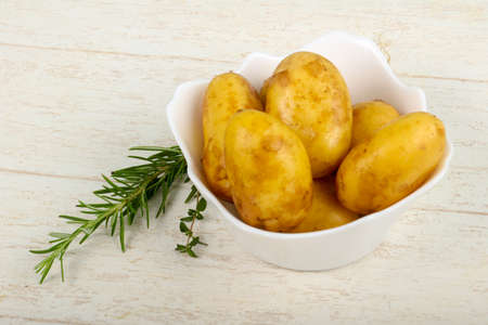 table top: Raw young potato with herbs