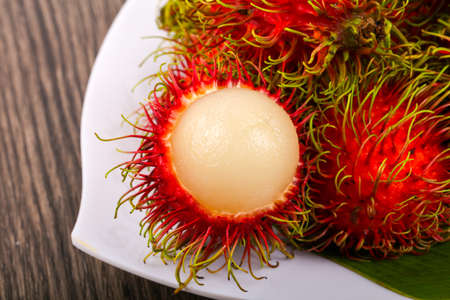 Fresh ripe sweet Rambutan heap - asian fruit Stock Photo