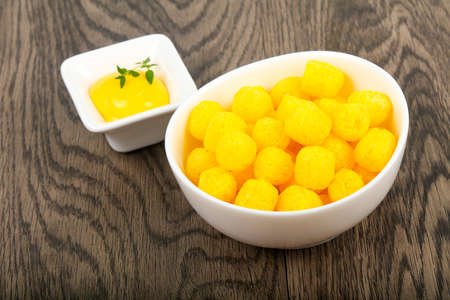 Cheese corn balls with sauce