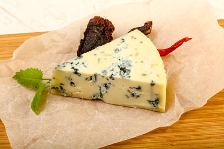 danish: Blue cheese with mint over the wooden background