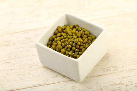 mung: Dry green beans heap over the wooden background