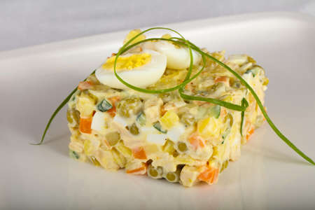 Russian salad with quail egg Stock Photo