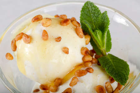 Ice-cream with cedar nut and mint leaves