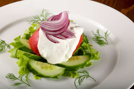 Salad - tomato, cucumber and onion with cream