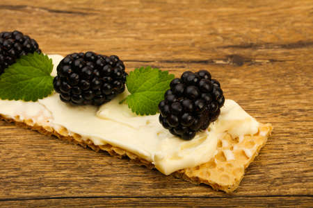 Toast with soft cheese, blackberries and leaves Stok Fotoğraf